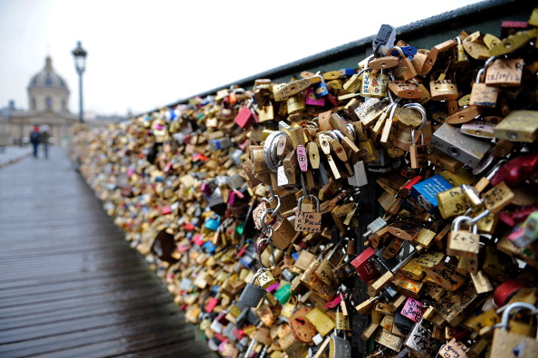 PARIS, FRANCE - FEBRUARY 14:  A view of the Pont Des Arts on Valentine's Day on February 14, 2014 in Paris, France. The accumulation of the 'love locks', a phenomenon popular in many European cities, where couples attach a lock to symbolise their love to the mesh panels on the sides of the bridge, is starting to pose safety concerns, due to their mass weight.  (Photo by Kristy Sparow/Getty Images)